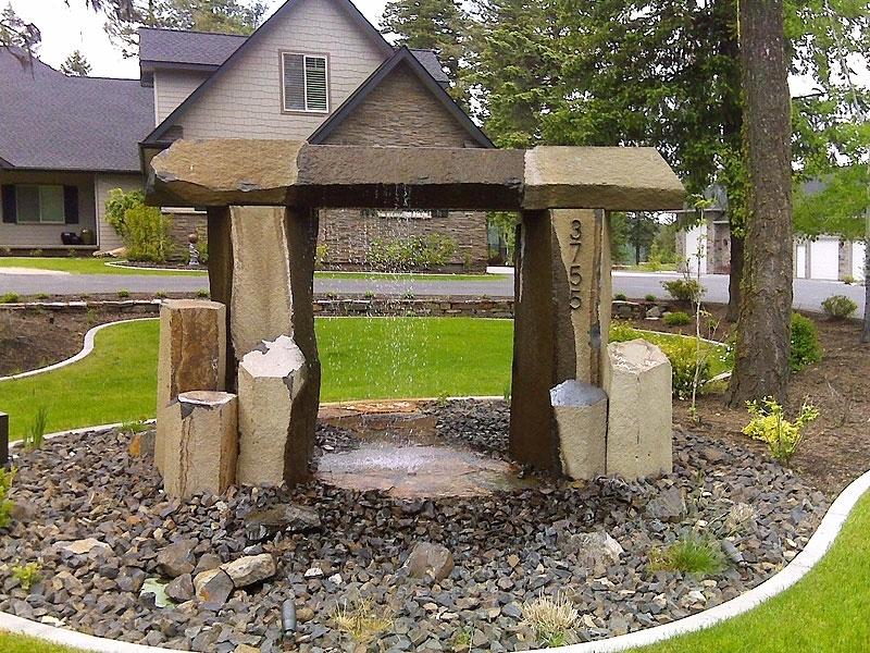 Basalt archway fountain