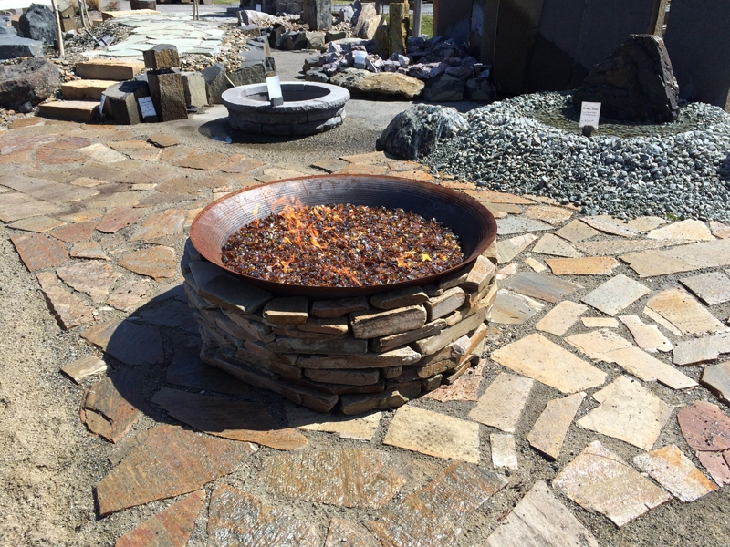 Steel fire pit filled with glass beads
